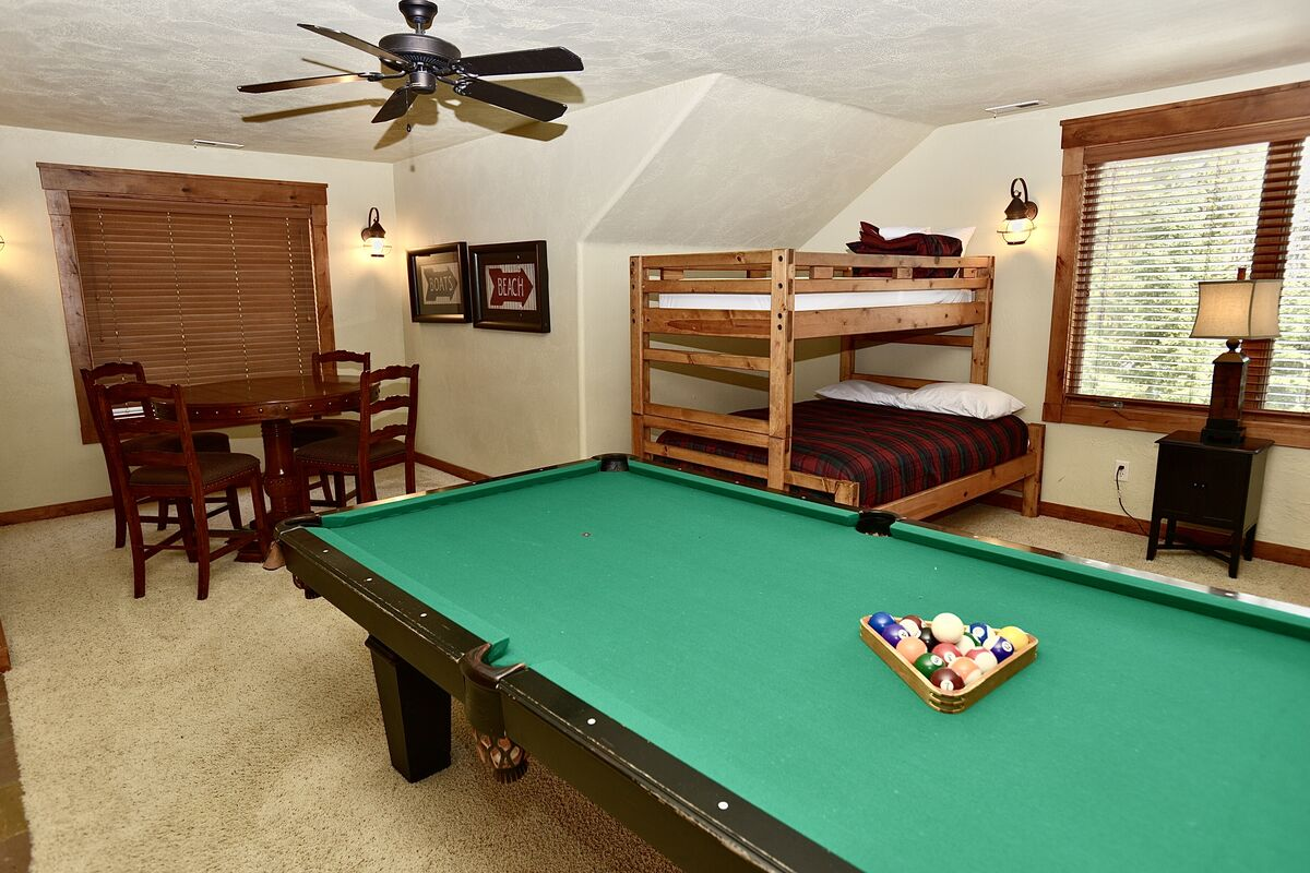 game table with pool table and guest bunkbeds