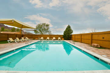 Shared Pool and Outdoor Seating at Moab Rental