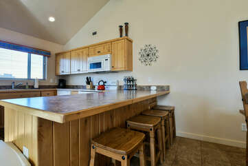 Kitchen Area with Bar Seating at Moab Rental