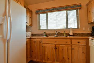 Kitchen Sink and White Fridge