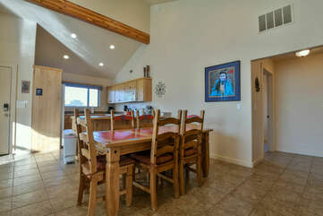 Dining Area with Large Wooden Table at Moab Rental