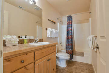 Shared Bathroom with Shower and Soaking Tub Combo