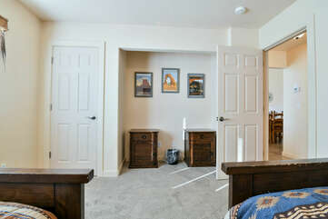 Third Bedroom with two Beds and a Closet