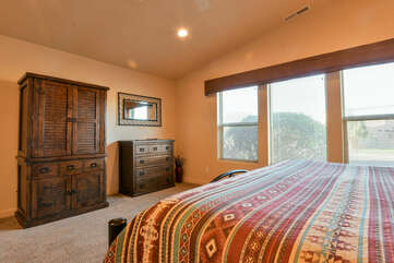 Furnished Master Bedroom with Large Windows