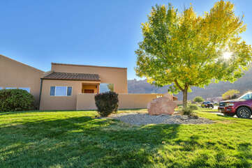 Large Tree and Grassy Area Backing Up to Moab Rental
