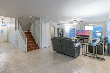 Staircase leads to the 4 bedrooms and 2 baths on the second floor.