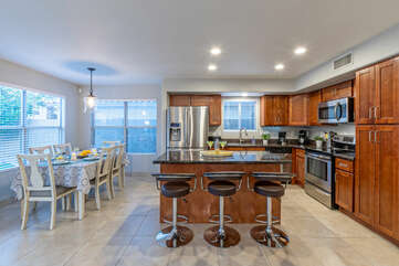 When you prefer to stay home for meals, this kitchen has both table and island seating.