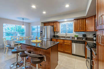Open and modern kitchen is spacious and inviting.