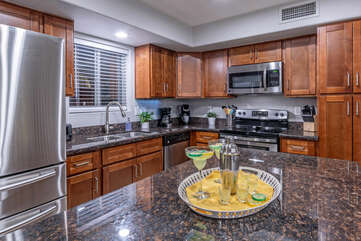Well designed kitchen has ample counter space for prepping and serving tasty cuisine.