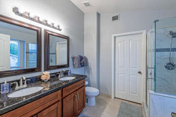 The primary suite bath is spacious and has a separate walk-in shower.