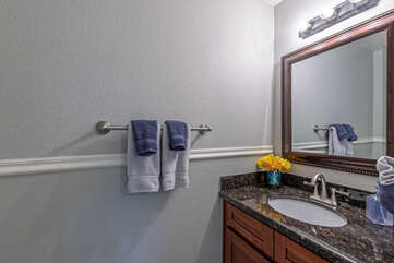 A powder room is conveniently located on the first floor.