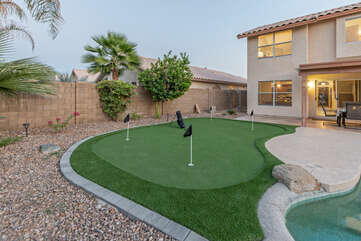 Another wow! A private putting green to warm up your shots before heading to a nearby course.