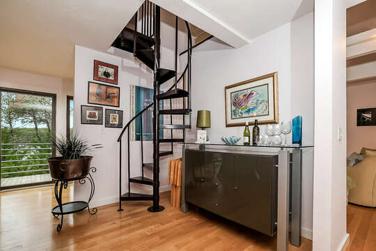 Enjoy creating your favorite cocktail at the dry bar and the spiral stairs to the loft bedroom-10 Cranberry Hollow Harwich-Cape Cod- New England Vacation Rentals