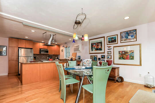 Dining table with seating for 6 looks into the open concept kitchen-10 Cranberry Hollow Harwich-Cape Cod- New England Vacation Rentals