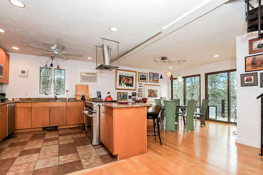Open concept kitchen and dining area, large gas stove and oven all with a view of the pond-10 Cranberry Hollow Harwich-Cape Cod- New England Vacation Rentals