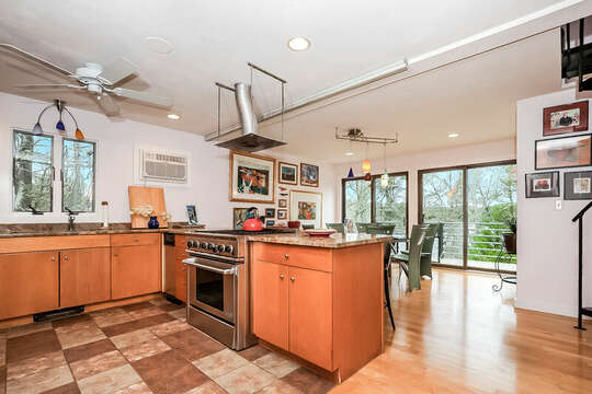 Kitchen and dining area, large gas stove and oven all with a view of the pond-10 Cranberry Hollow Harwich-Cape Cod- New England Vacation Rentals