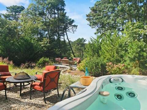 View from the hot tub of the 2 separate fire pits!- 10 Cranberry Hollow Harwich-Cape Cod- New England Vacation Rentals