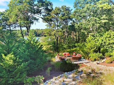 Views of the lower fire pit overlooking Aunt Edie's Pond-10 Cranberry Hollow Harwich-Cape Cod- New England Vacation Rentals