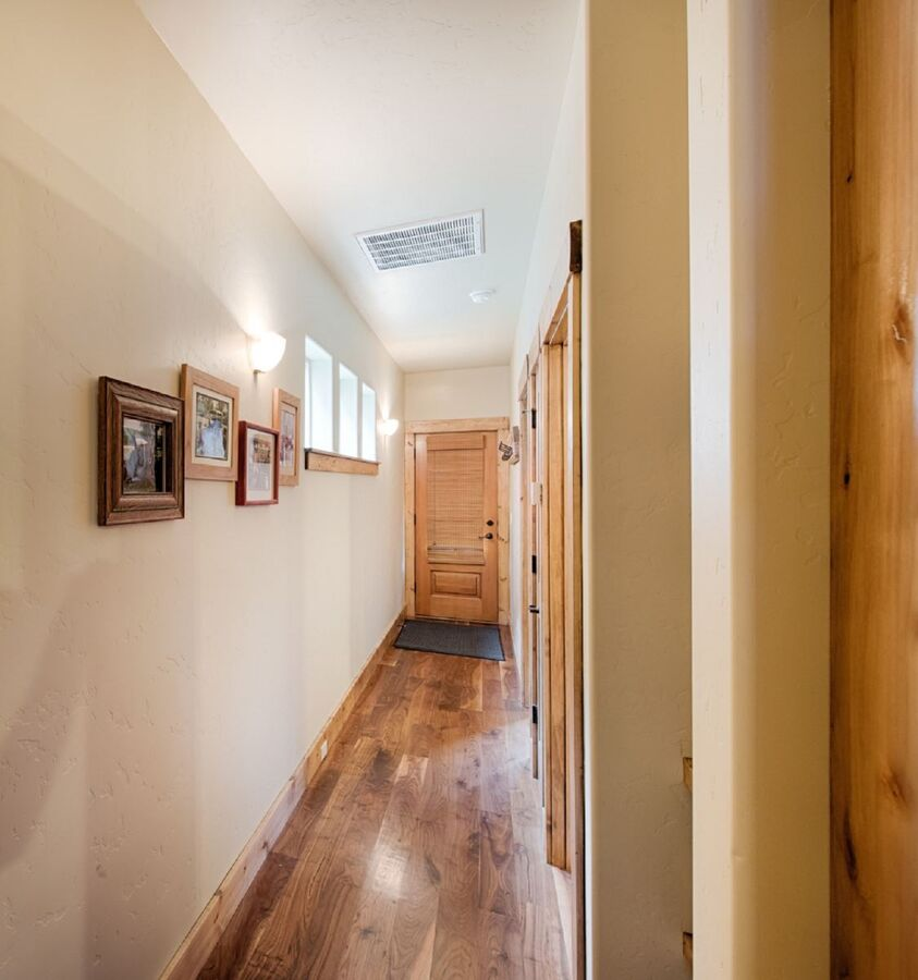 Lower level hall access to laundry, guest bath and guest bedroom.