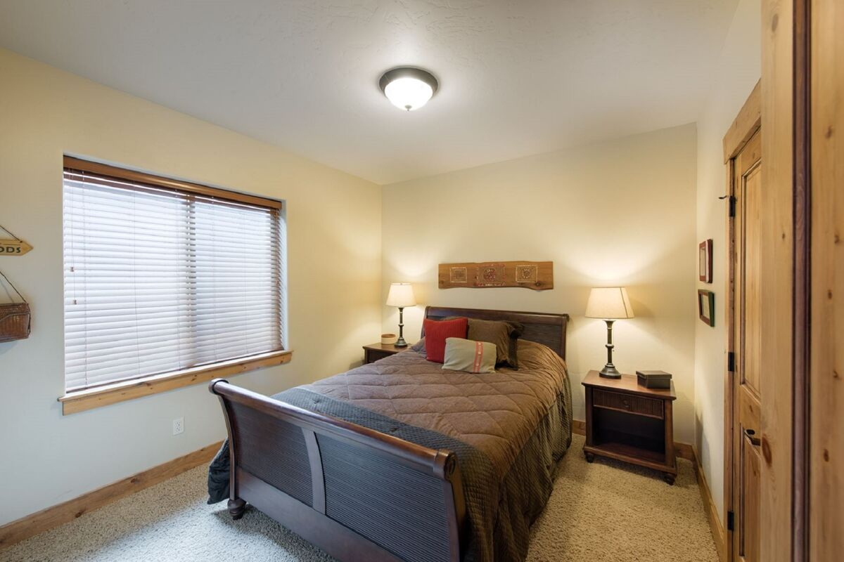 Main level guest bedroom located at back of home for peace and quiet.