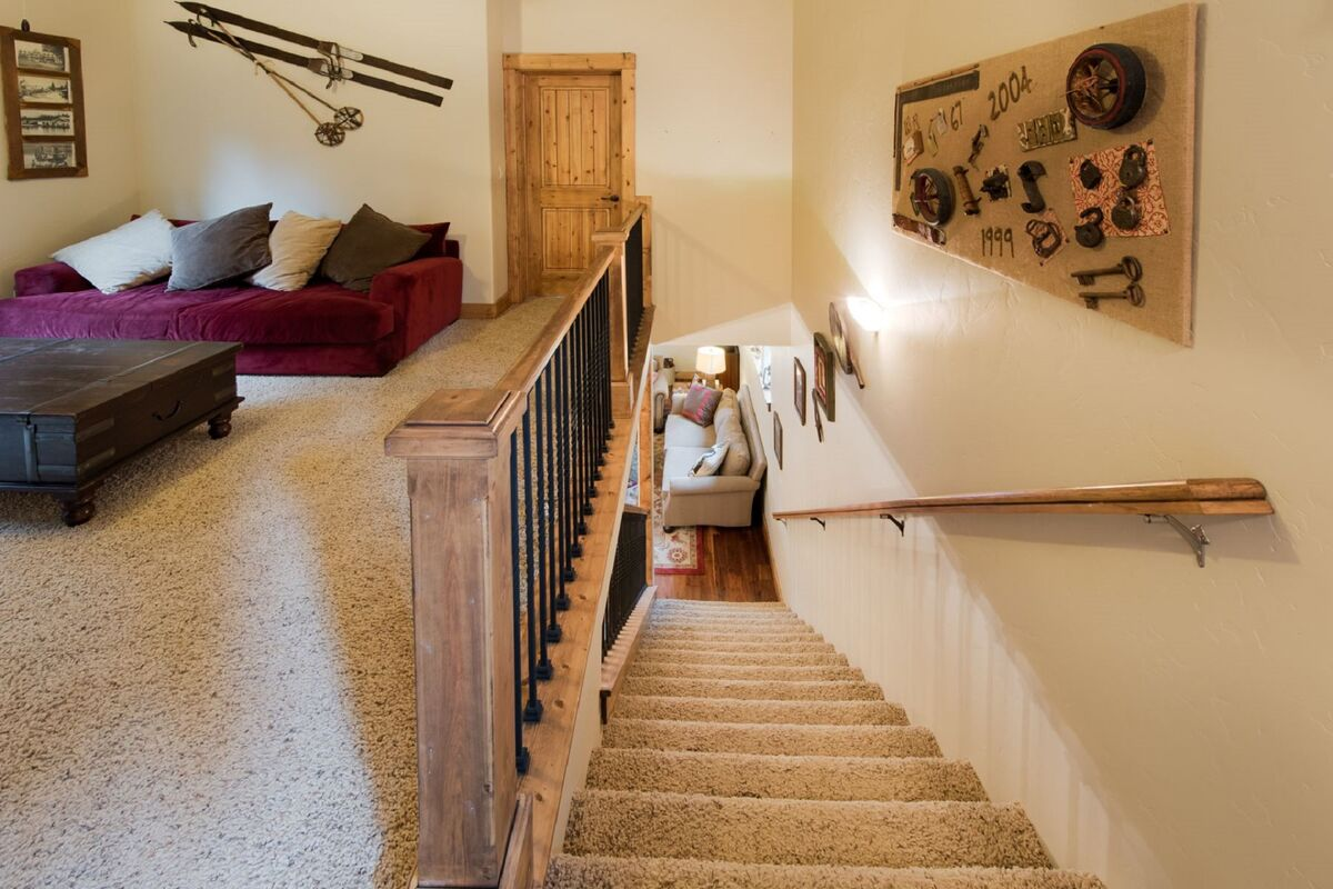 Carpeted stairwell to main level.