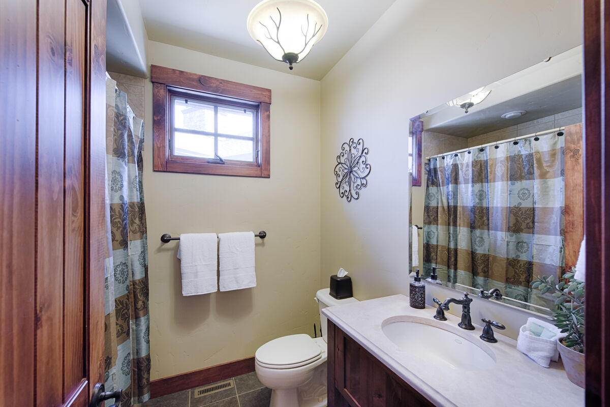 Hall access guest bath on lower level.