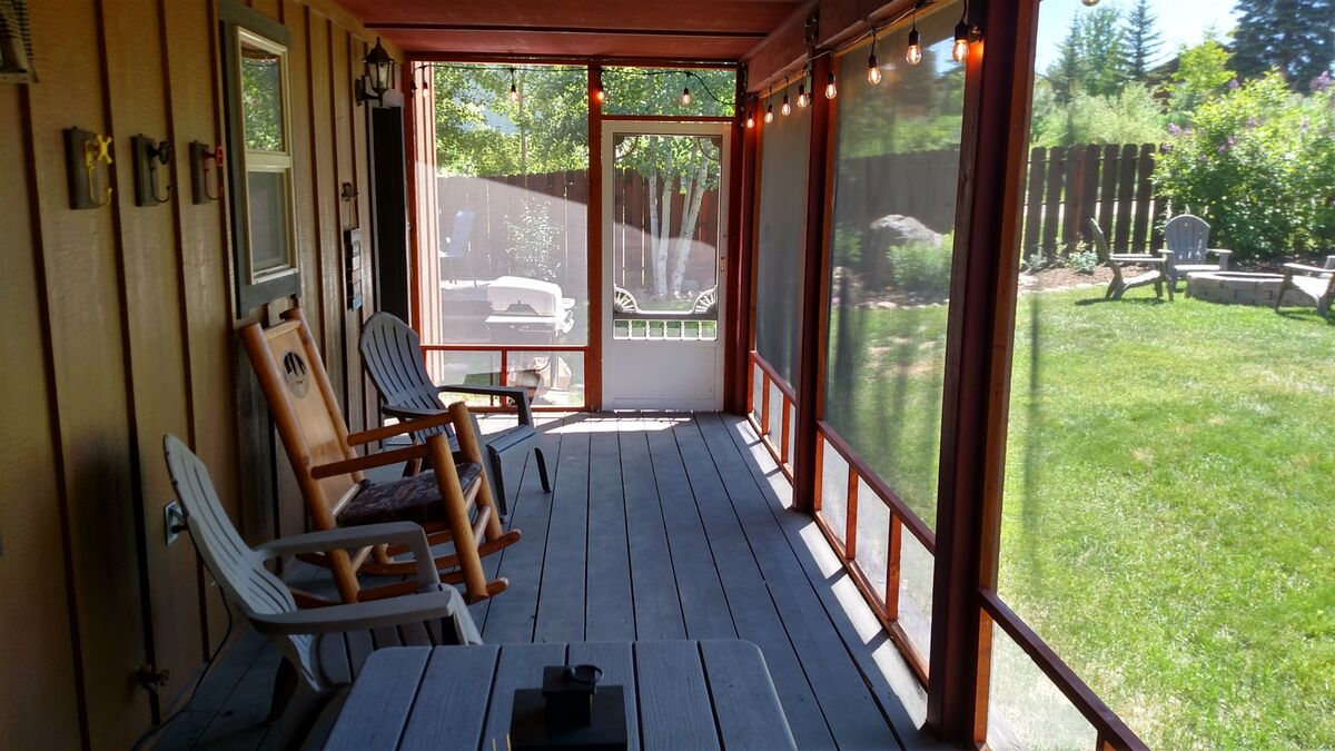 Lounge in cool shade on the screened porch.