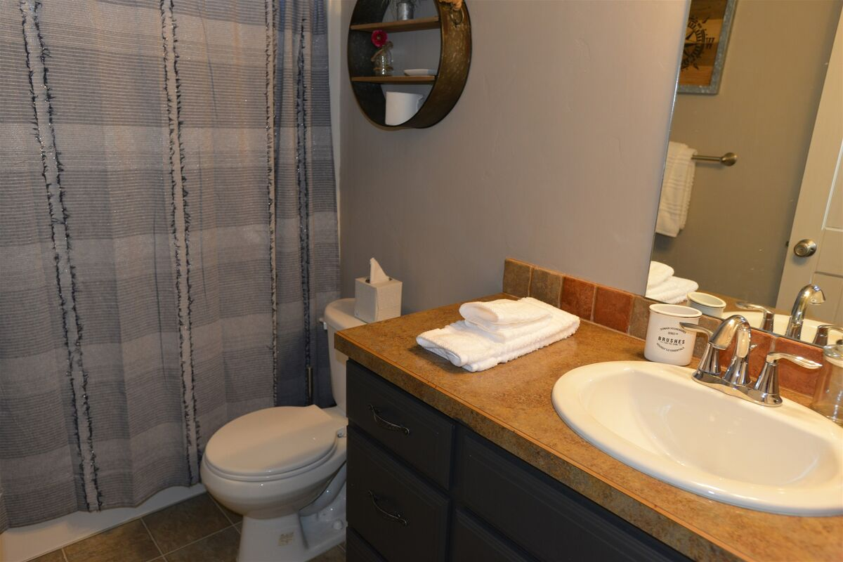 Upstairs guest bath has hall access.