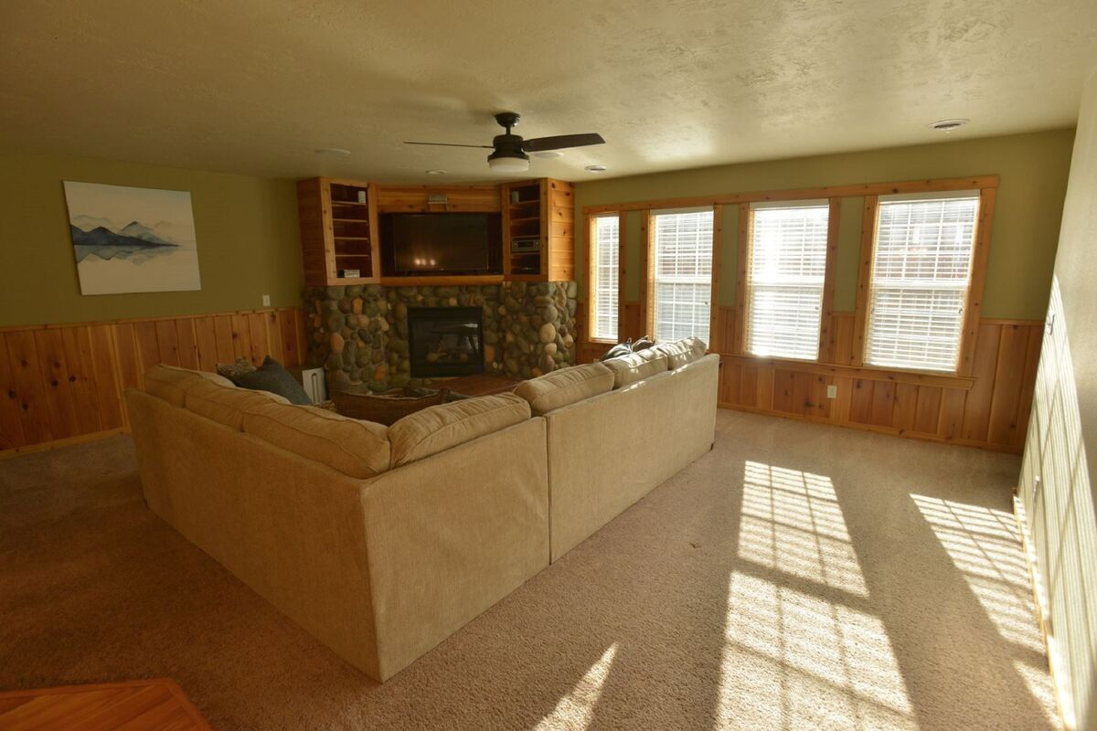 Bright space with comfy furnishings.  Stone hearth and propane fireplace.
