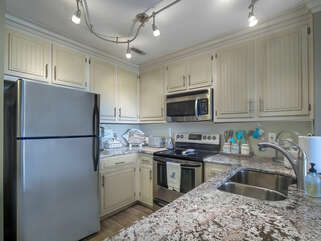 Fully equipped kitchen open to the living and dining space.