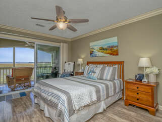 Queen size bed in a bedroom with a spectacular marsh view.