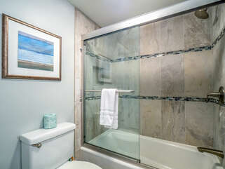 Renovated master bath with tub and shower.