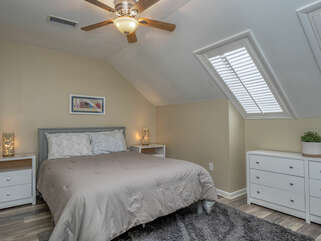 Third guest bedroom with queen bed and skylights