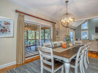 Dining area with screened porch through sliding doors