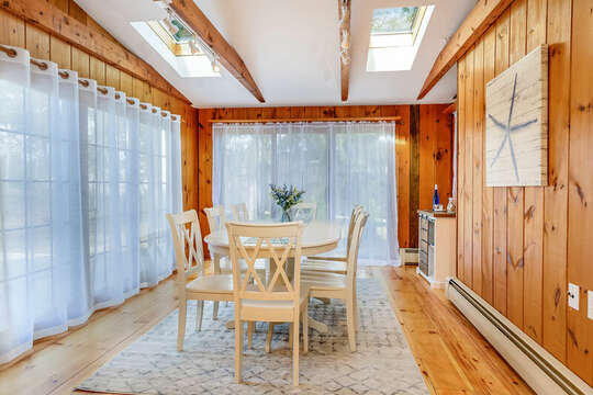 Sliders and windows show backyard views or close for privacy - 2 Cove Road Harwich Cape Cod - New England Vacation Rentals