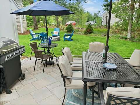 Patio with outdoor furniture and gas grill and fire pit - 2 Cove Road Harwich Cape Cod - New England Vacation Rentals