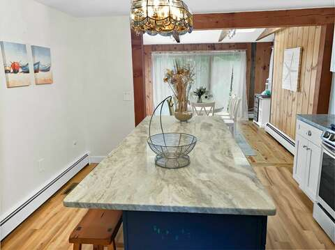 Updated kitchen with island bar seating open to dining room- 2 Cove Road Harwich Cape Cod - New England Vacation Rentals