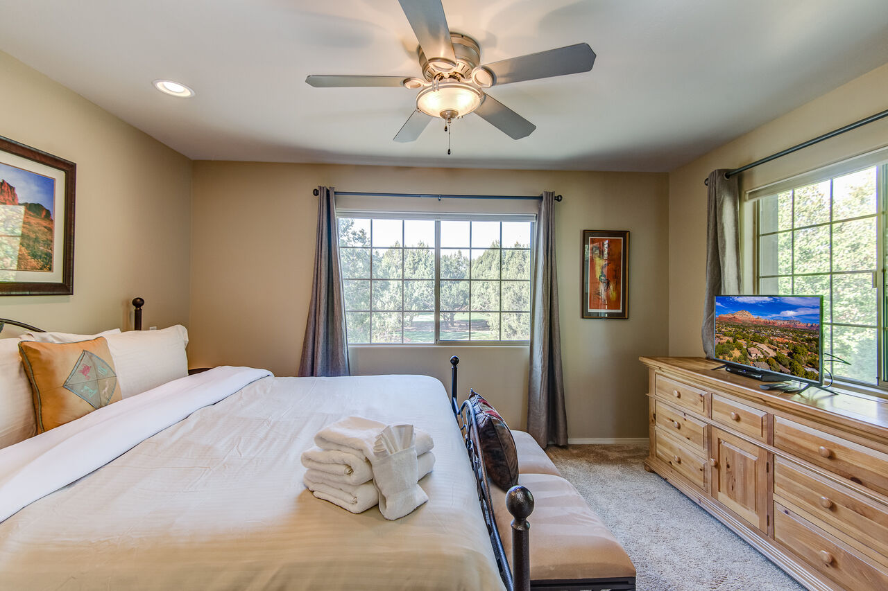 Master Bedroom with a King Bed and Smart TV with Cable