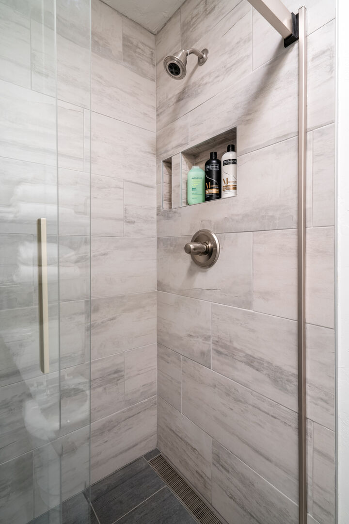 New tile shower with sliding glass door