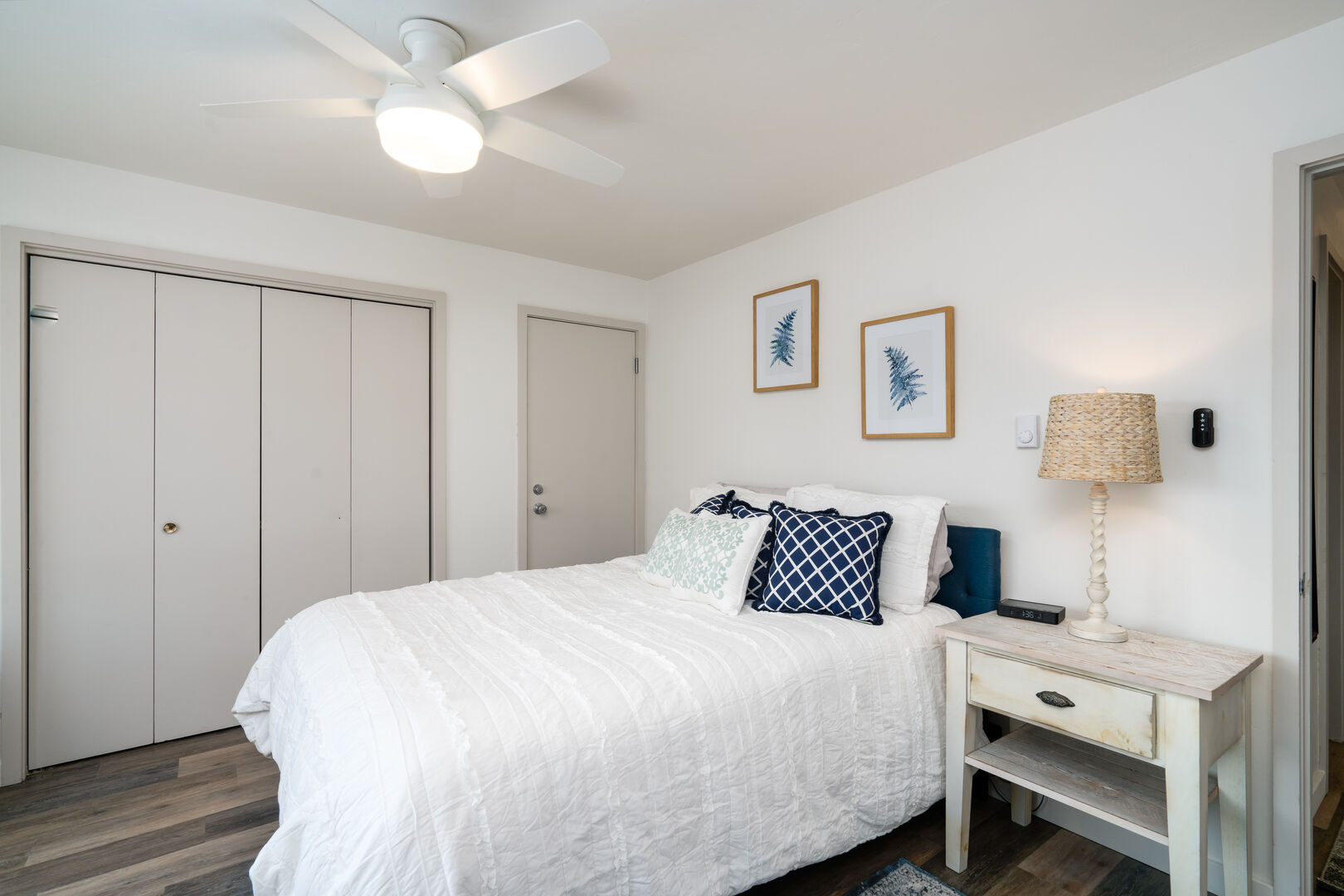 Queen size bed in the private 1 bedroom.