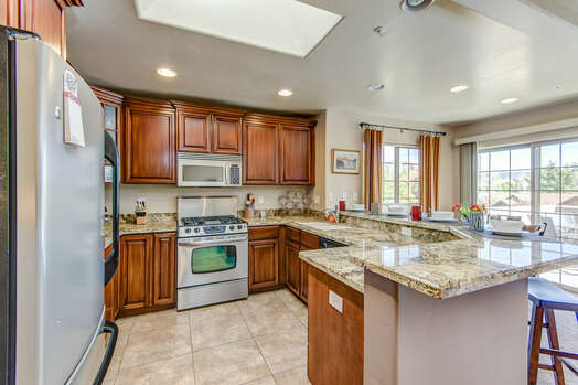 Fully Equipped Kitchen Offering Stainless Steel Appliances