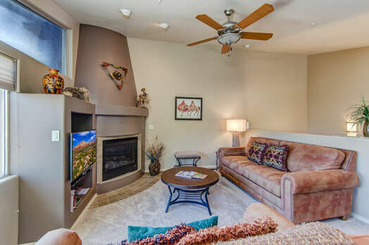Cozy Living Room with a Gas Fireplace and Smart TV with Cable
