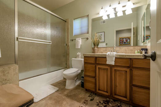 Full Shared Bath with a Tub/Shower Combo