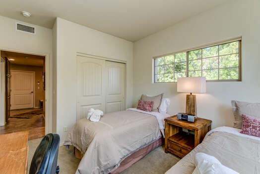 Bedroom 3 with Two Twin Beds and Access to a Full Shared Bath