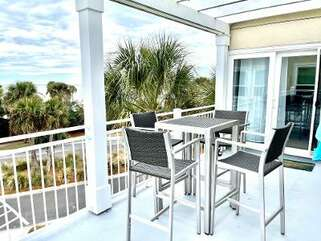 The deck is one of the wonderful features of this property with  incredible views that span the ocean and the club.