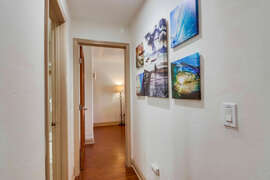 Hallway leading to 1st bedroom.