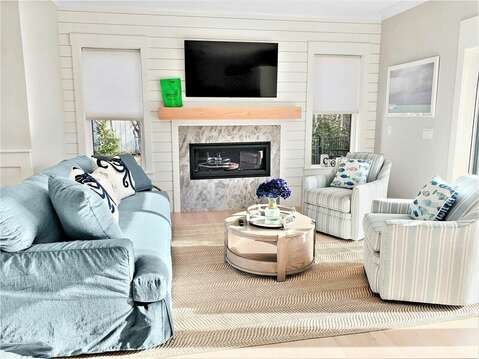 Comfy couch and swivel chairs with pool view through sliders-31 Pine Rd West Dennis- Cape Cod- New England Vacation Rentals