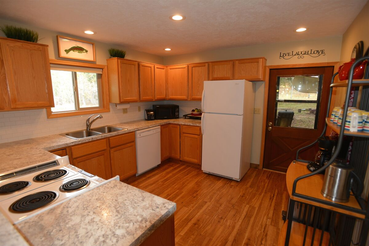 Full size oven and stove top.  Back deck access.