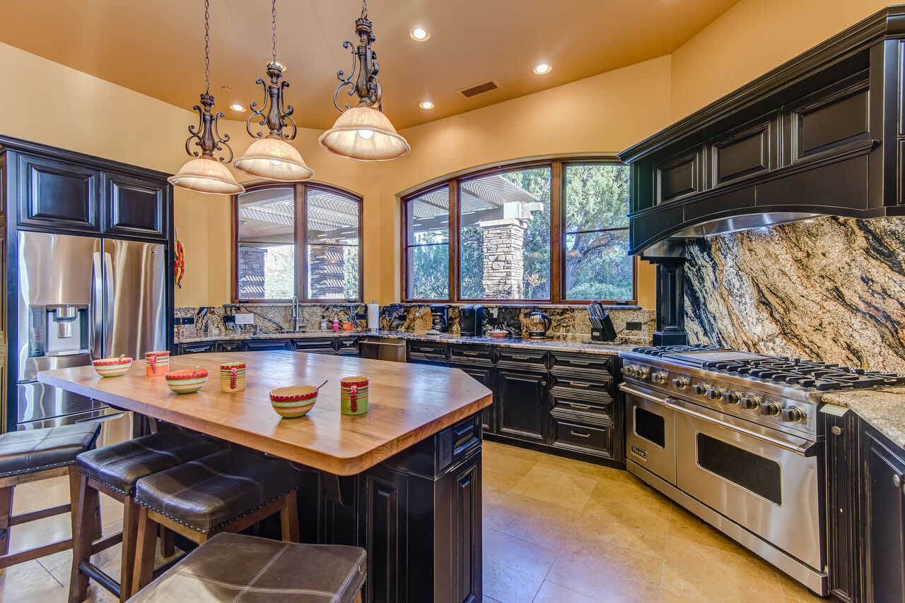 High-end Stainless Steel Appliances and Butcher Block Island with Seating for Four - Viking 6-Burner Gas Range with a Griddle and Double Ovens