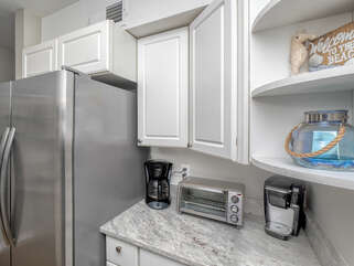 Toaster oven, coffee maker both Keurig and drip . Blender and hand mixer as well as pots and pans. This unit comes equipped to make your stay complete.